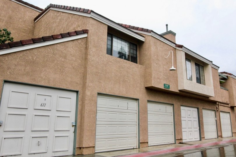 Simple brown building with white garages in Evergreen Village, Anaheim CA