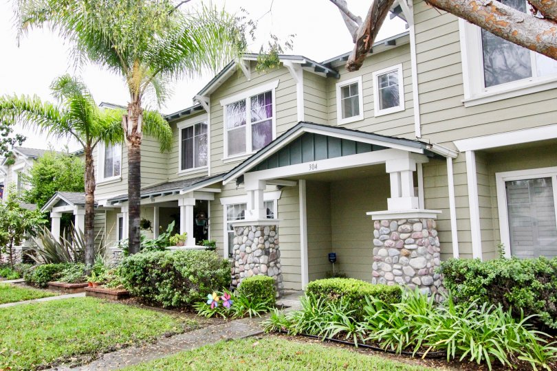 A beautiful house with palm trees and well maintained lawn in the Heritage place bungalows community