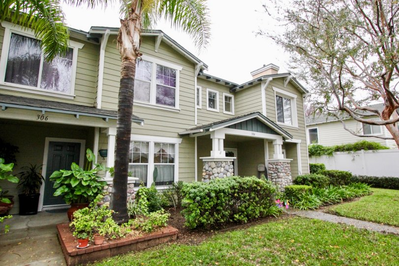 Awesome green colour villa with trees and lawn in Heritage Place Bungalows of Anaheim