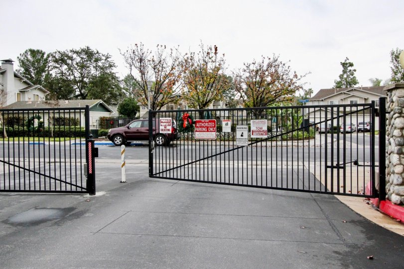 Large metal black gate opes to Heritage Place Cottages community