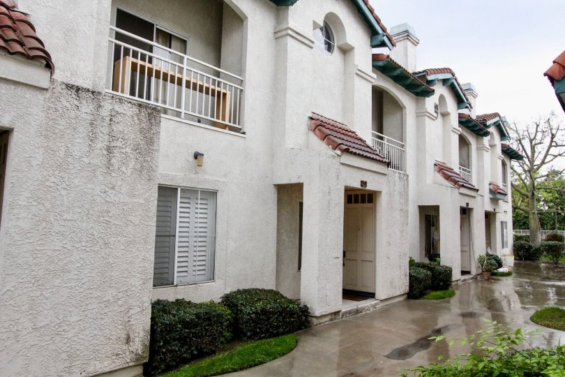 Nice view of villa with balconies on a rainy day in La Vie En Rose of Anaheim