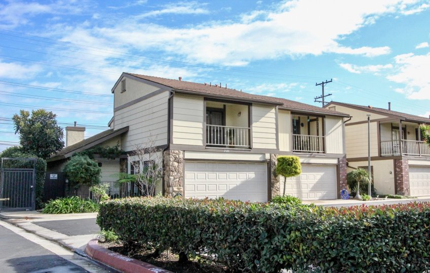 Bright sunny day near villas with small garden in Meadowview of Anaheim