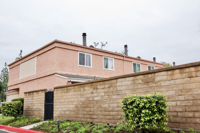 Fabulous view of villa with dish antennas and garden in Northwoods Village of Anaheim
