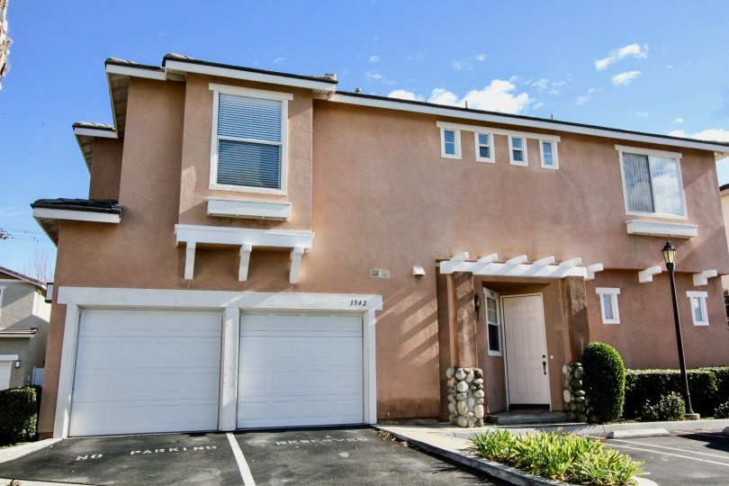 A sunndy day in the Peppertree Walk community featuring single car garages, Anaheim California.