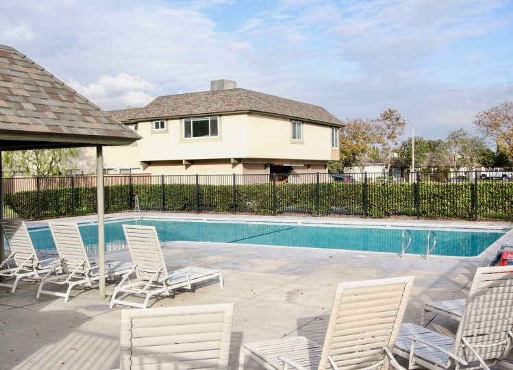 Swimming pool area with clean water and clean chair in Ridgeway park East of Anaheim