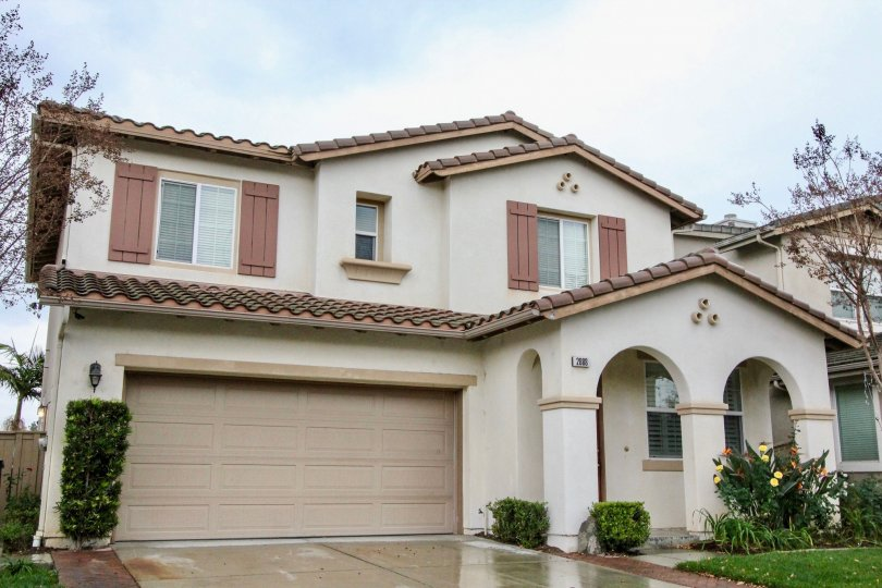 Residing in the commnity of Rio Vista Walk, Anaheim California, a two-story home with beautiful front entrance.