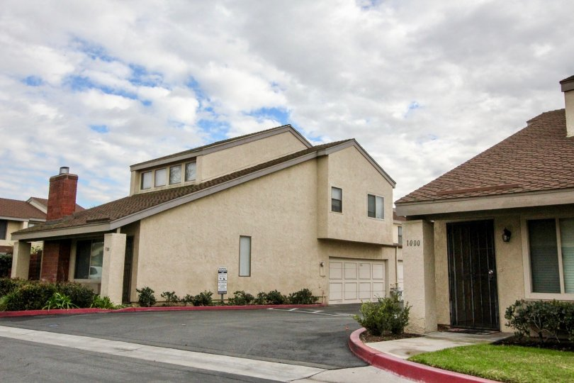 Street view of two homes, separated by a road, in Sherwood Village, Anaheim, CA