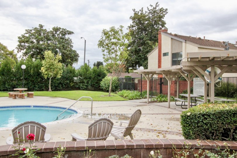 An estate in sherwood village with comprises the houses and outbuildings and swimming pools with picnic table