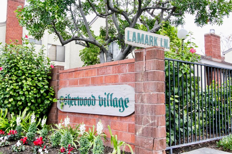 Excellent view of Villa with garden and name plate in Sherwood Village of Anaheim