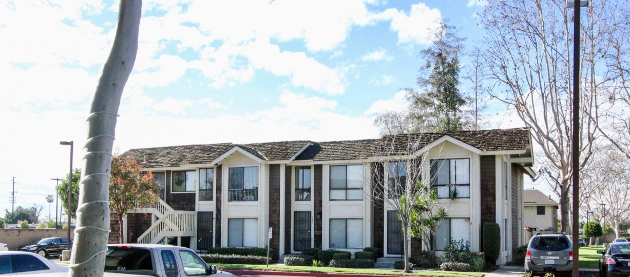 THE BUNGALOW IN THE SUTTER CREEK TOWNHOMES WITH THE CAR PARKING, PLANTS, TREES