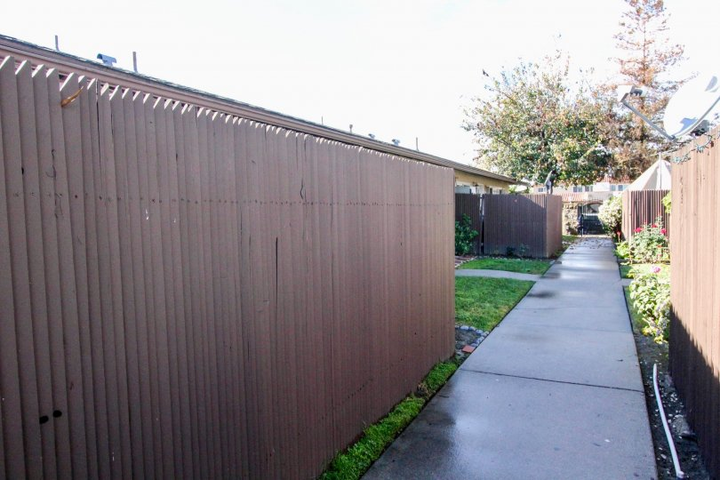 A fence surrounding a green lawn in The Pines neighborhood of Anaheim