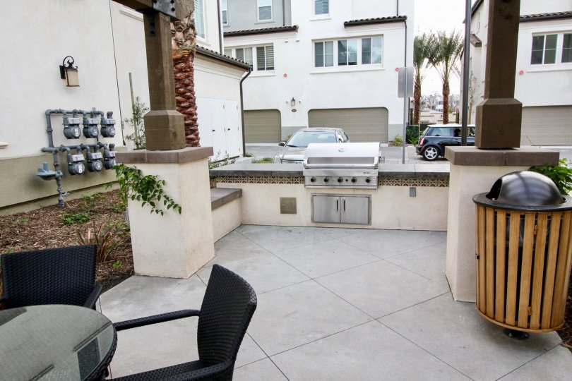 An outdoor common area with a BBQ grill in the Aldea Walk community