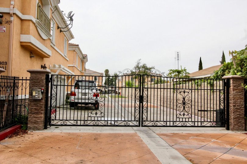 THIS IS THE GATEWAY TO THE APARTMENTS, INSIDE THE CAR IS THERE, PLANTS, TREES ARE SHOWN IN BUENA PARK CITY