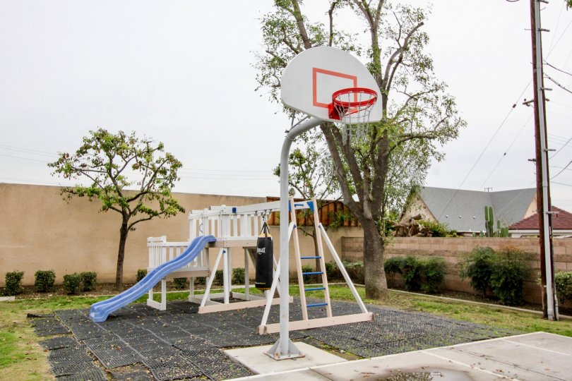 A park in the Buena Villa Townhomes with a basket ball court.