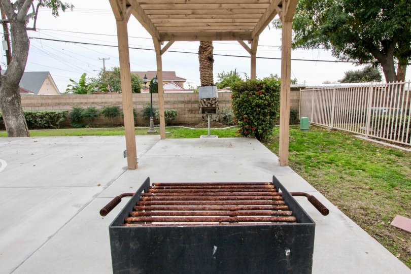 Place in Buena Villa Townhomes has griller, meadows with flowers in plants