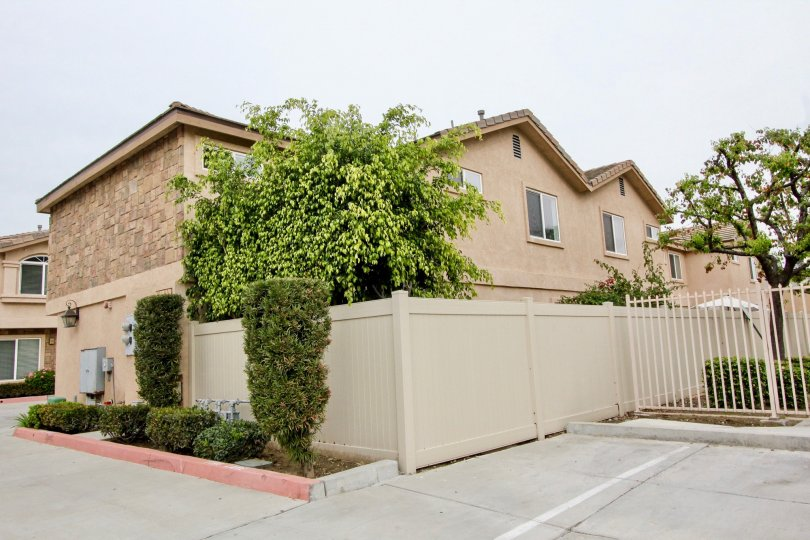 Out side view of a home with garden in Buena Villa TOwnhomes at Buena Park of california