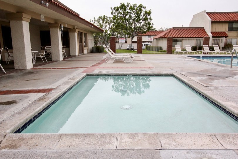 The place in Casitas California has both children's and adult's swimming pool with seating chairs