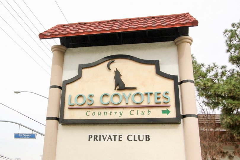 The entrance sign and logo for the Los Coyotes Village