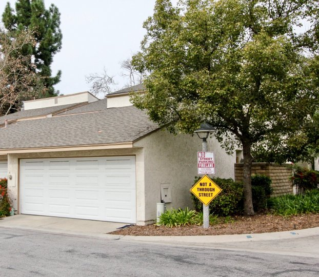 THIS IMAGE SHOWS THE SHED WITH PLANTS, TREES, NAME BOARD LOCATED IN BUENA PARK