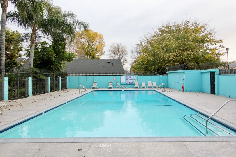 A lovely blue community swimming pool in Monticello Townhomes in Buena Park