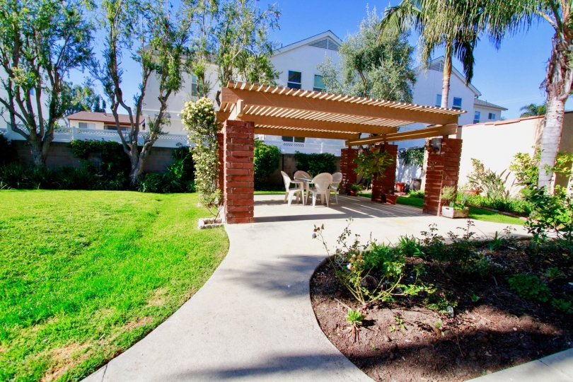 A nice backyard area with a table under an outting in Alta Mesa community.