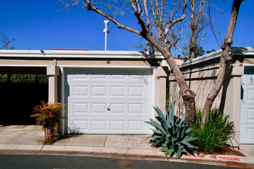 The front individual garage entrances in the community of Brighton Springs in Costa Mesa, California.
