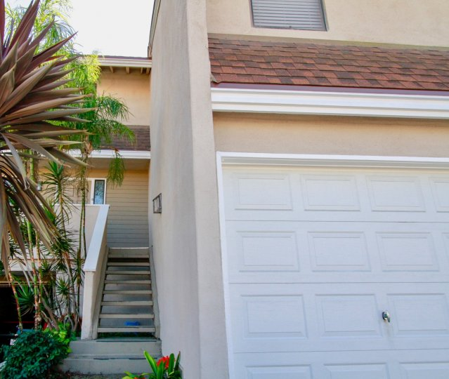 Excellent view of villa with stair case and trees around in Brighton Springs of Costa Mesa