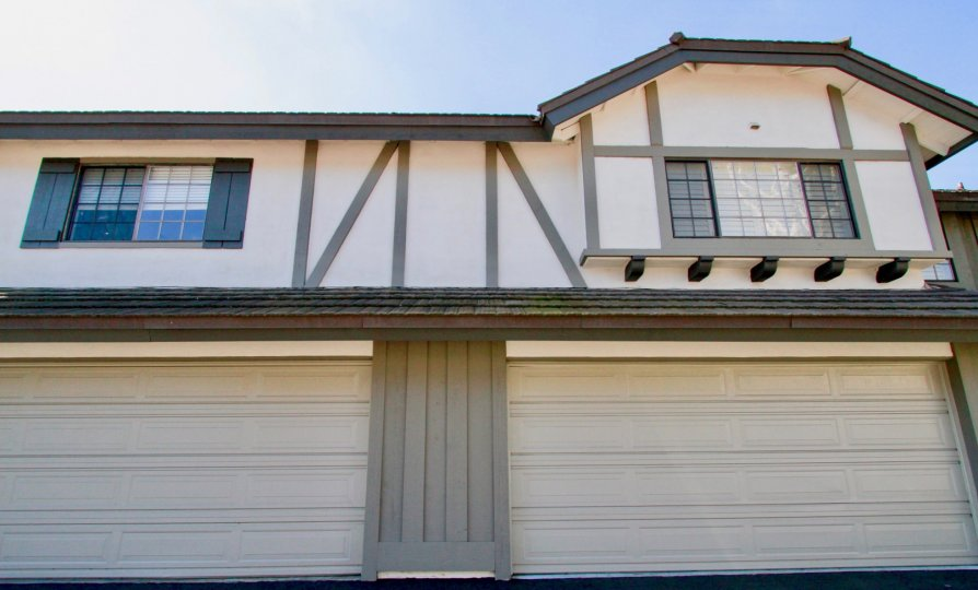 A double door garage with ustairs windows in the Brittanywoods community of Costa Mesa California