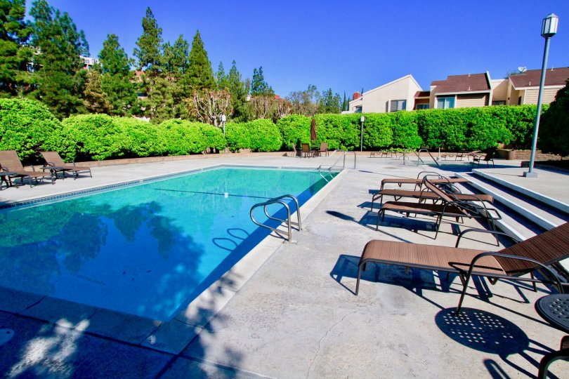 Fabulous swimming pool with sitting place near villas in Brookview of Costa Mesa
