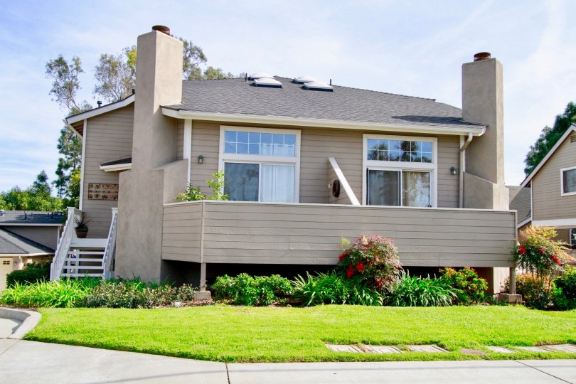 Rear decks and manicured lawns of Canyon Walk homes in Costa Mesa California