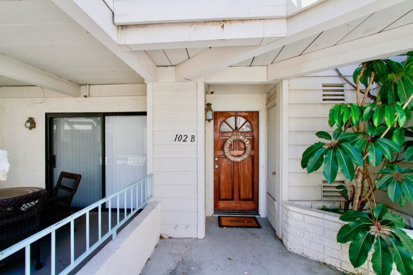 The walkway and front door to a unit at Coral Point, Costa Mesa, California.