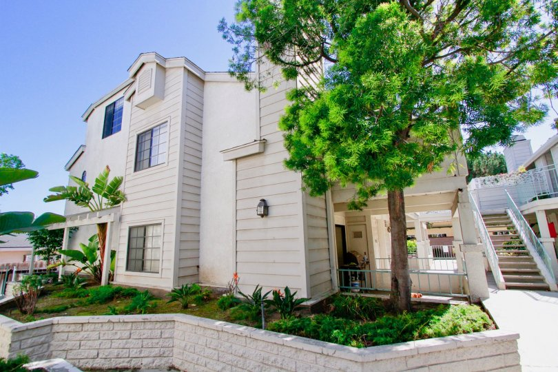 Nice view of Villa with green trees and staircase in Coral Point of Costa Mesa