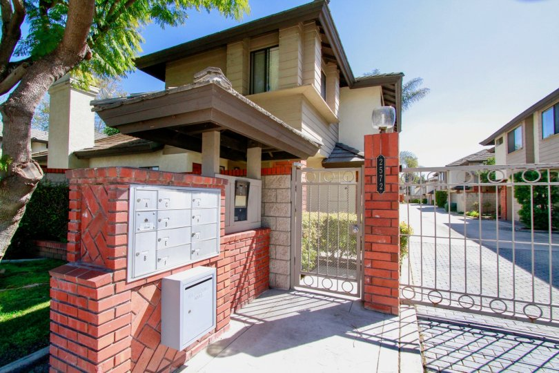 Front gate and mailboxes for homes of Elden Shadows in Costa Mesa California