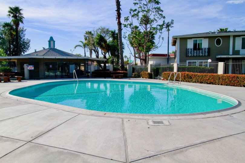 Large community pool and outdoor space on a sunny day in the French Quarters community in Costa Mesa, CA