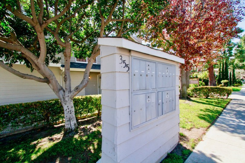 Mailboxes shown in front of the colorful trees of Harbor Pointe South Community residing in Costa Mesa, California