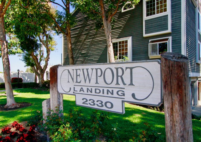 THE BUILDING WITH A FRONT SIGN THAT REPRESENT THE NEWPORT LANDING AND SOME TREES ALSO AVAILABLE.