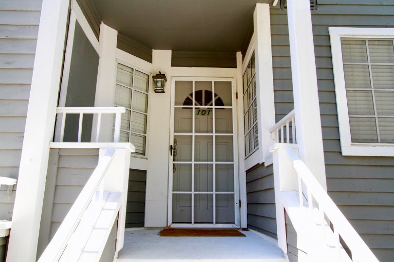 Beautiful entrance view with steps in a modern built villa of Newport Landing in Costa Mesa