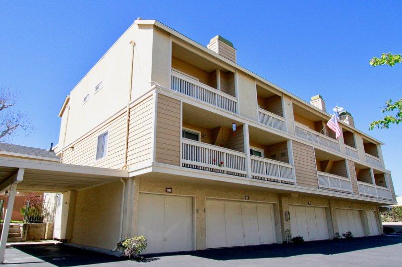 Side view of Ocean Breeze Villas garage doors and terrace in Costa Mesa, CA