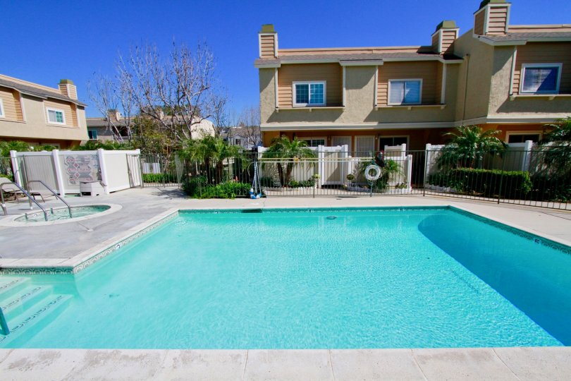 Poolside beautiful view hot tube and chairs at Ocean Breeze Villas located in Costa Mesa, California