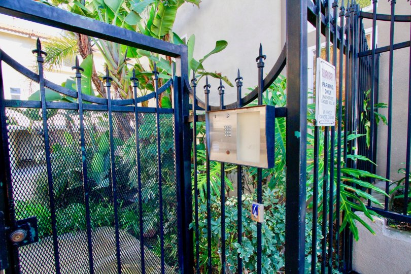 The gated entrance and the intercom to Palermo Townhomes in Costa Mesa, California