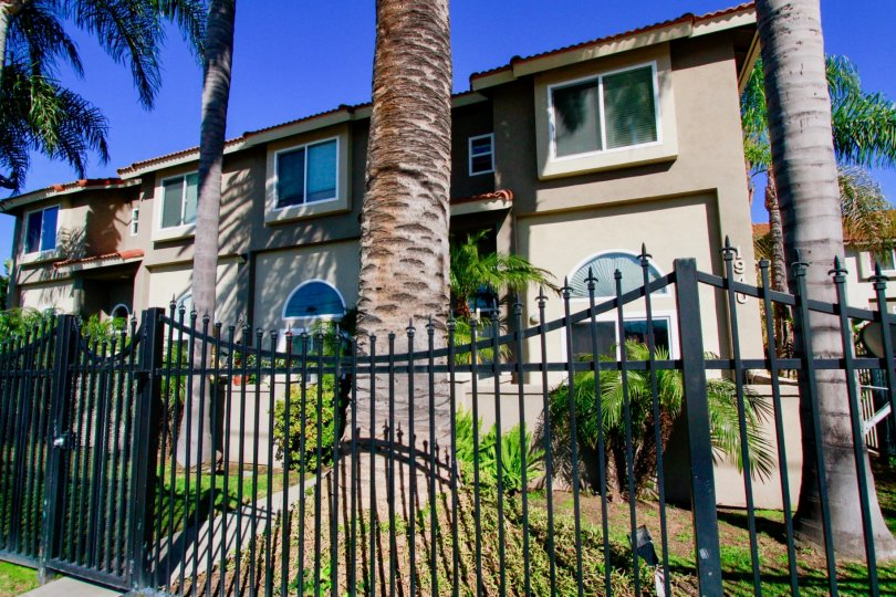Palermo Townhomes Costa Mesa California house fully cover the font side gate near to garden