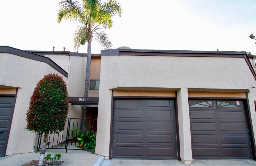 Two door garage with brown doors inside Sommerset at Costa Mesa CA