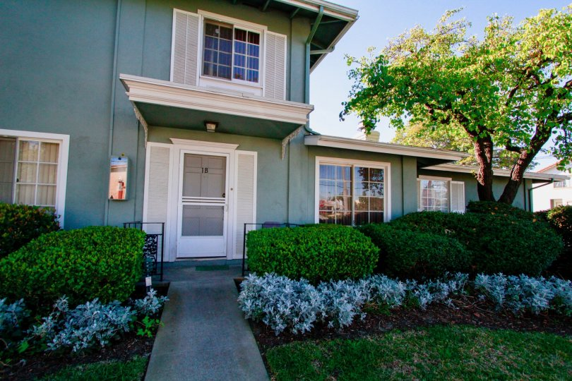 A two story townhome with faux shutters at The Vendome in Costa Mesa