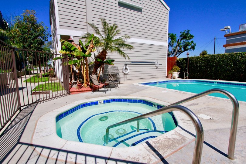 Awesome looking swimming pools with palm trees near villas in Victoria Garden Villas of Costa Mesa