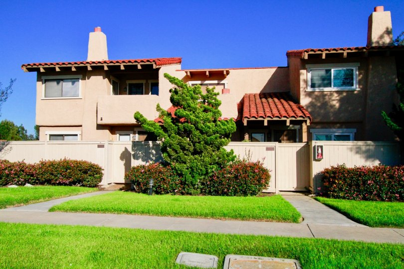 Westbluff Village Costa Mesa California small building with good shaped lawn and roofing technology