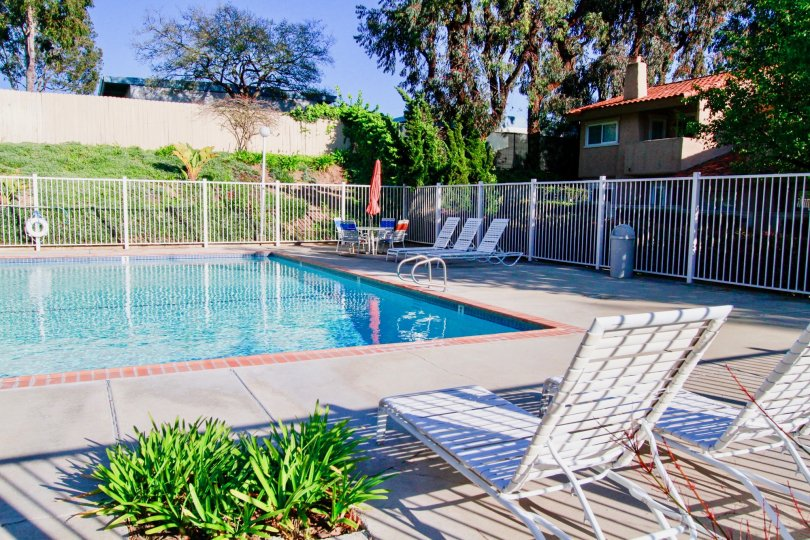 Westbluff Village Costa Mesa California house near swimming pool cover gate blue water