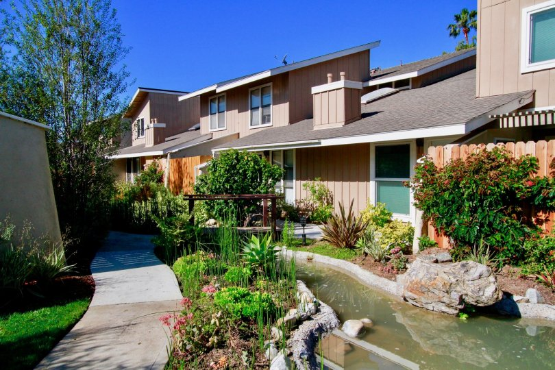 Excellent View of Villa with small stream of pond with trees in Woodstream Condos of Costa Mesa