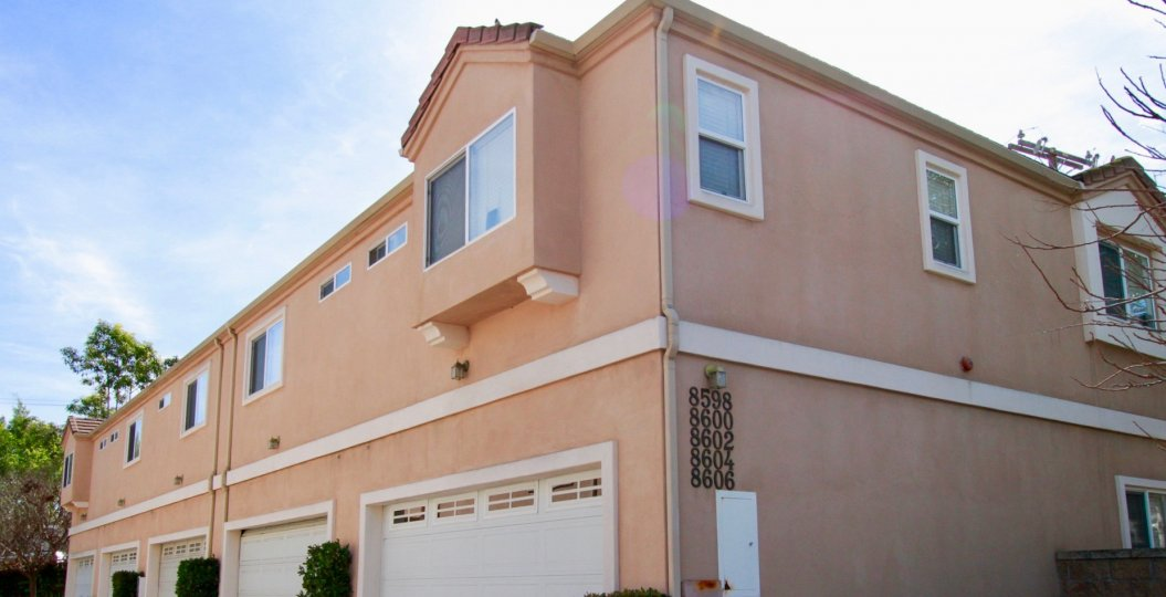 Beautiful pink apartment building in Belmont Grace community of Cypress, California