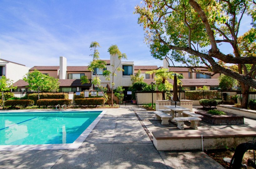 Bowers Condominiums Cypress California blocks with colored trimmed plants and stone benches and grill gates