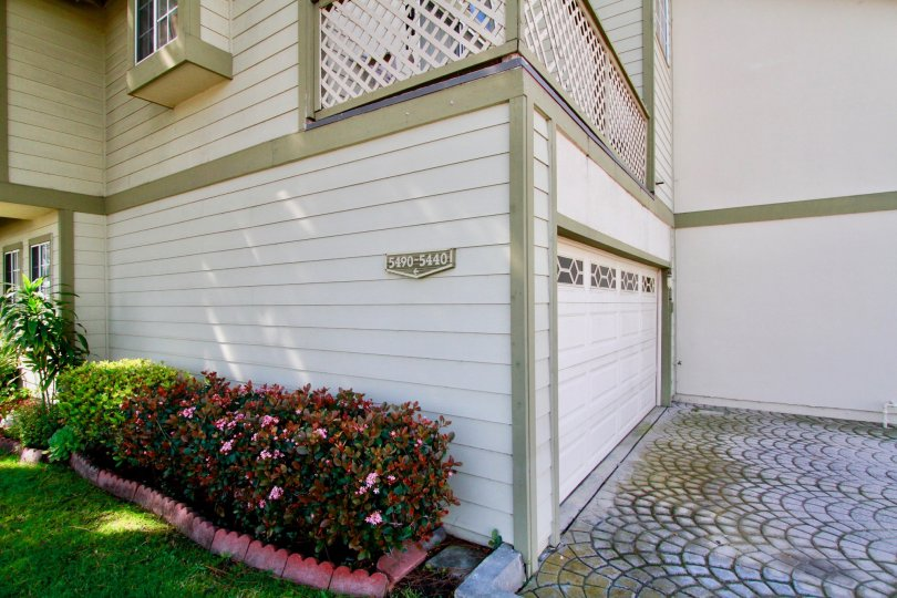 a garage with a beautiful lattice porch on top in a house in Cambridge Commons.
